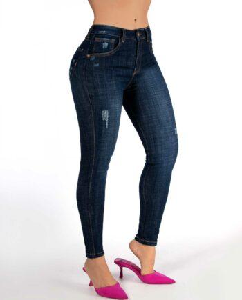 Jean skinny oscuro con desgaste