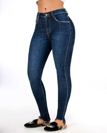 Jean skinny tono oscuro con desgaste
